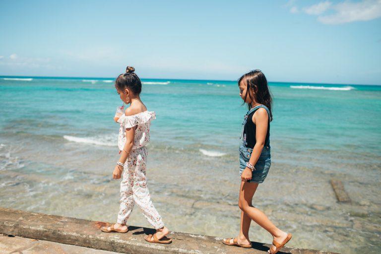 Melia + Kiele enjoying a fruit smoothie and stroll along the beach wall.