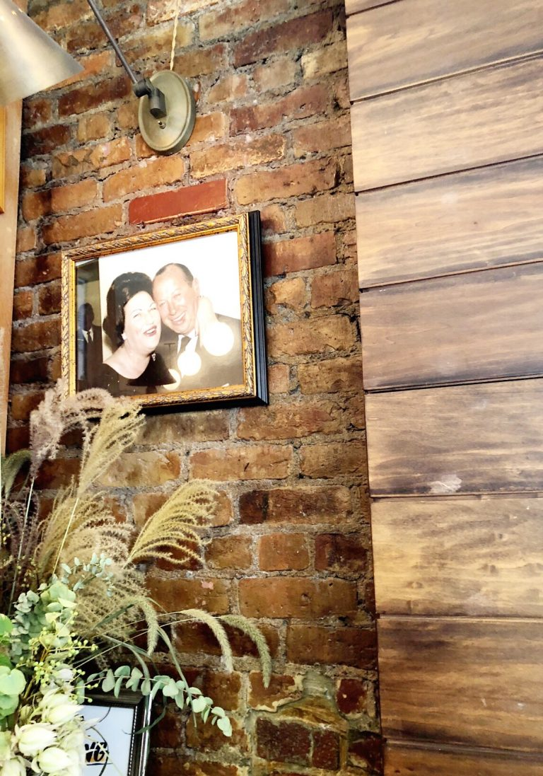 "A photo of the owner's Grandparents, ""Jack"" and ""Freda"" is placed by the front entrance."